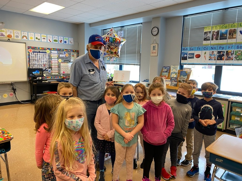 Mrs. Harp's  First Grade helps Mr. Smith celebrate
